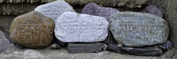 Buddhist carvings on stones - Seattle Insight